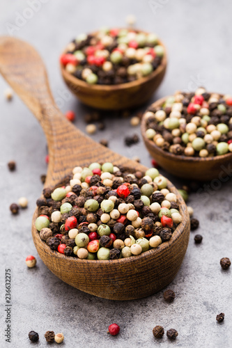 Fotobehang Aromatische Peppercorn mix in a wooden bowl on grey table.