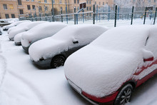 Cars Under Snow In The City Co...
