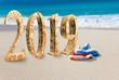 New Year inscription 2019 on the beach