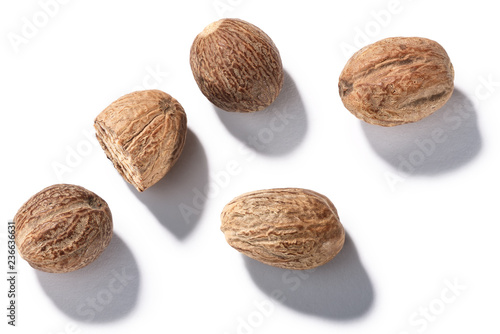 Fototapeta Whole nutmegs seeds of M. fragrans, top, paths obraz
