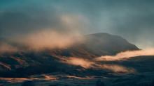 Fog Over Mountains At Sunrise