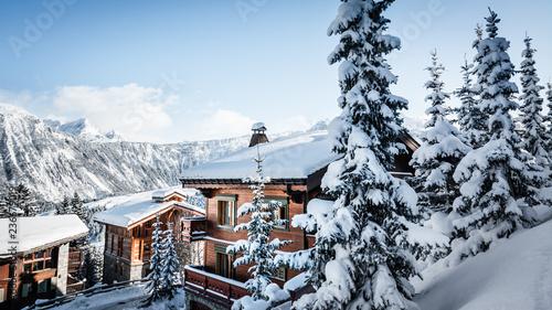 Fotografie, Obraz Sun on a mountain Courchevel village in the French Alps in winter