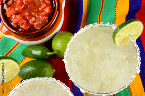 Fotomural Margaritas and Salsa on a colorful  table cloth, with limes, and peppers