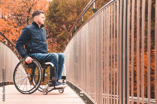 Valokuva  Man in a wheelchair use a wheelchair ramp.