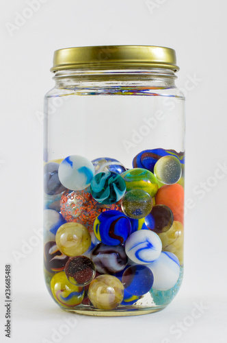 Cuadros en Lienzo Jar of vibrant colored marbles.