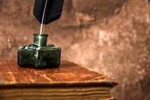 Old Inkwell And Quill Pen. Vin...
