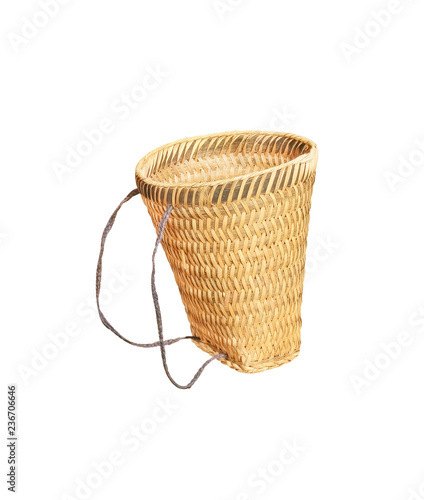 Fotografiet  Woven bamboo basket bag with rope isolated on white background and clipping path