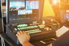 Live Streaming Concept. Director Working On The Video Or Media Switcher To Edit Of Switcher Buttons In Studio  And Broadcast Video.