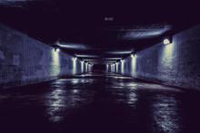 Empty Dark Tunnel At Night With Lights