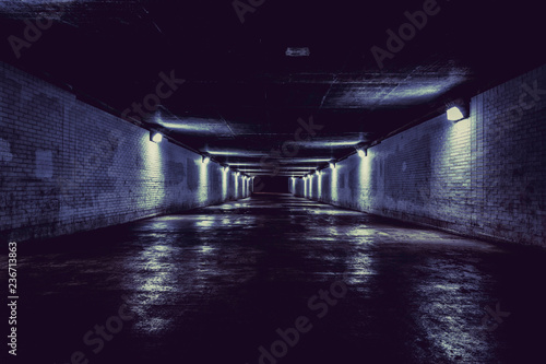 Empty dark tunnel at night with lights