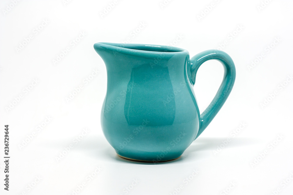 Fototapety, obrazy: Green small ceramic pitcher on white background for utensil and dishware concept