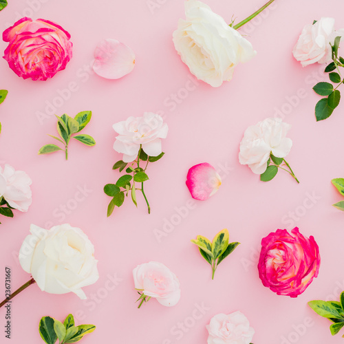 Foto op Canvas Bloemen Floral pattern composition with white and red roses flowers and leaves on pink background. Flat lay, top view.