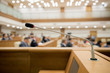 Leinwandbild Motiv Session of Government. Conference room or seminar meeting room in business event. Academic classroom training course in lecture hall. blurred businessmen talking. modern bright office indoor