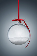 Empty Transparent Christmas Ball Over Gray Background With Copy Space