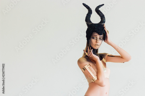 The model wears a hat of Maleficent and has makeup in the Halloween theme Canvas Print
