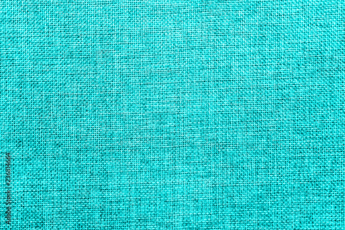 Photo  Burlap background colored in turquoise blend