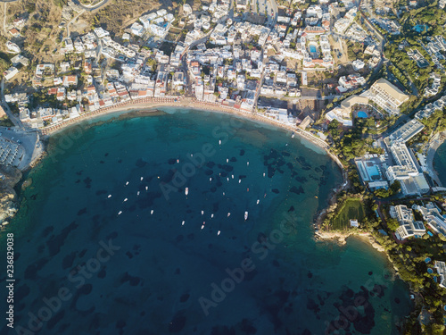 Aerial drone photo of beautiful bay with sandy beach and cretan village of Agia Pelagia, Greece