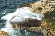 Waves Crashing On Rocks At Sch...