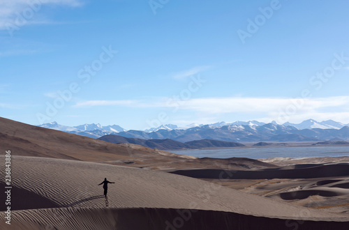 Deurstickers Asia land An unidentified tourist over sand dunes in Western Tibet, China