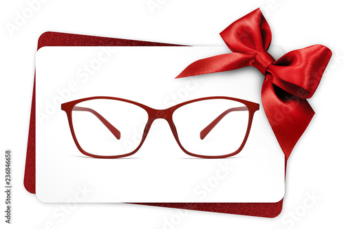 Fotografia eyeglasses gift card, red spectacles and red ribbon bow, isolated on white backg