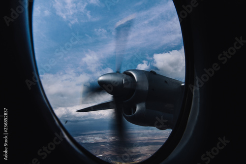 Fotografia, Obraz  Turboprop engine view from illuminator with aerial bright background
