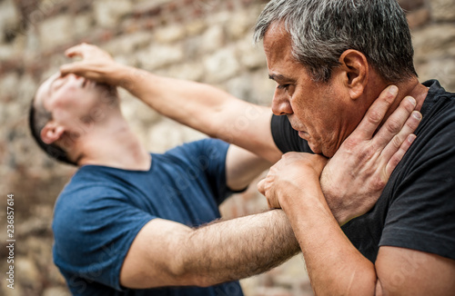Kapap instructor demonstrates street fighting self defense techniques Canvas Print