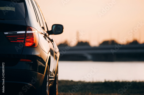 Photo  Rear taillight of modern luxury suv car