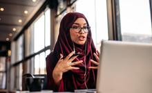 Businesswoman In Hijab Having ...
