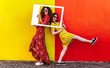 canvas print picture - Girls posing with empty picture frame
