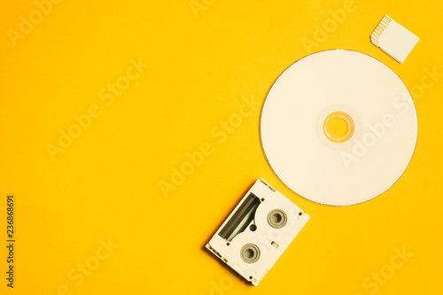 Valokuvatapetti Compact disc and memory card on yellow background