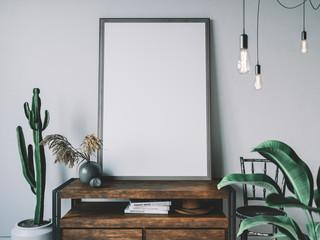 Empty poster frame in cozy interior. Frame mockup.