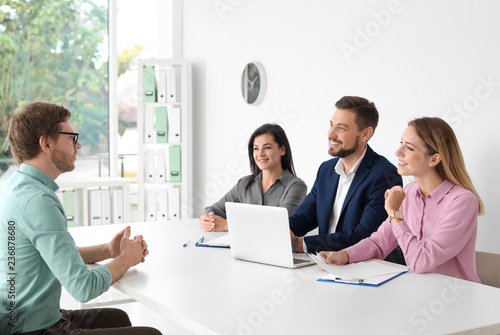 Human resources commission conducting job interview with applicant in office Canvas Print