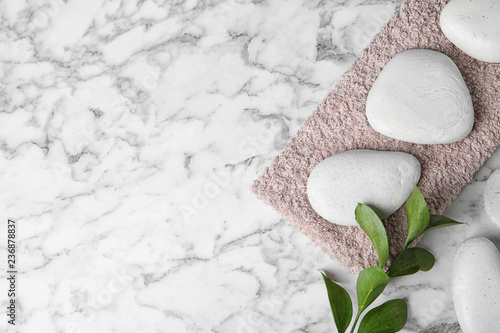 Flat lay composition with spa stones and space for text on marble background