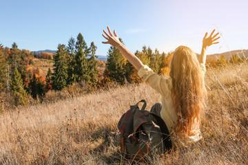 Female traveler feeling free in peaceful mountains