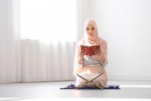 Muslim Woman In Hijab Reading ...