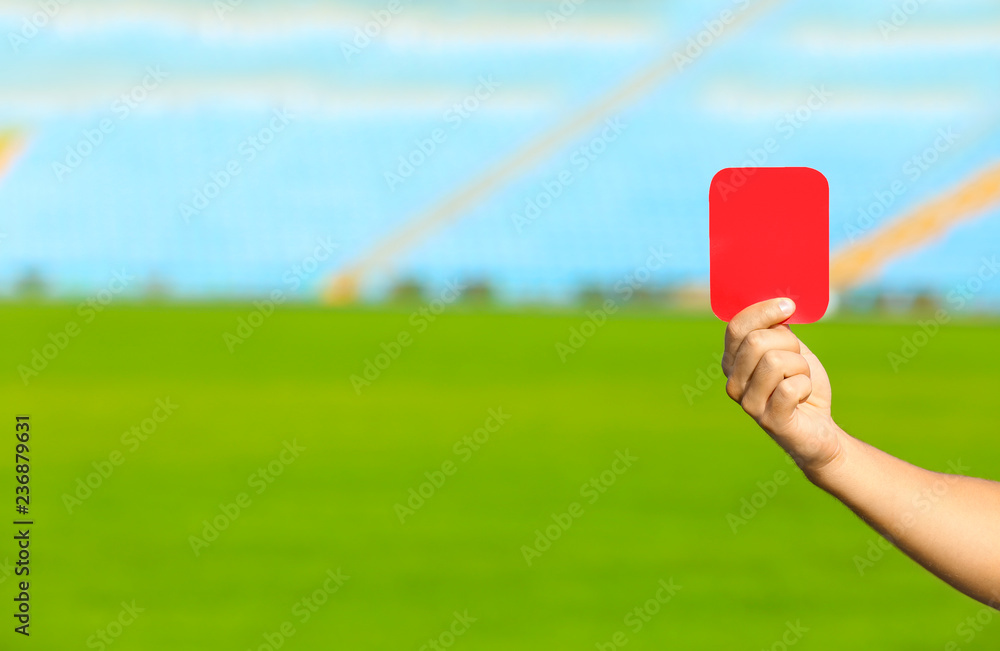 Fototapety, obrazy: Football referee showing red card at stadium, closeup with space for text