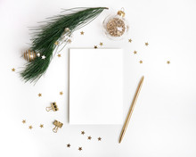 Christmas Composition In Gold. Paper Blank Mock Up, Christmas Fir Tree Branch With Glass Ball Decorations, Star Confetti, Pen On White Background. New Year Flat Lay, Top View, Copy Space, Square