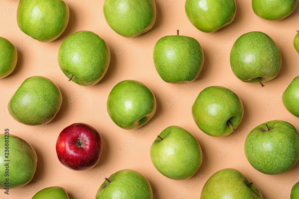 Fototapety, obrazy: Red apple among green ones on color background, top view. Be different