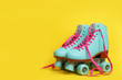 Leinwanddruck Bild - Pair of stylish quad roller skates on color background. Space for text
