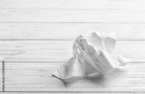 Fotomural  Crumpled napkin on wooden background, space for text