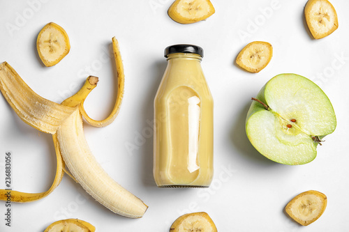Flat lay composition with bottle of juice on white background