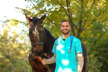 Veterinarian In Uniform With B...