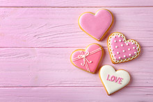 Decorated Heart Shaped Cookies On Wooden Background, Flat Lay With Space For Text. Valentine's Day Treat