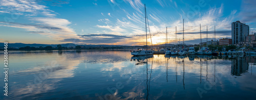 Photo  Boats moored on the port of Olbia at sunset, Sardinia, Italy