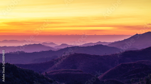Tuinposter Zwavel geel Colorful landscape view in early morning before the sunrise with misty covered mountain hills at Thong Pha Phum. Kanchanaburi, Thailand