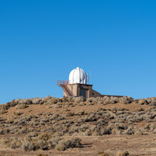 Weather Observatory On Top Of Mountain With A Bright Blue Sky.