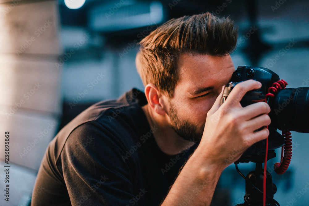 Fototapety, obrazy: Photographer taking a photo with a dslr
