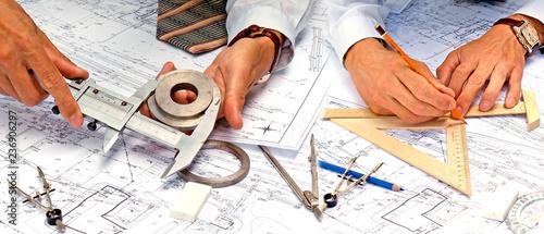 Fototapeta teamwork in engineering designing obraz
