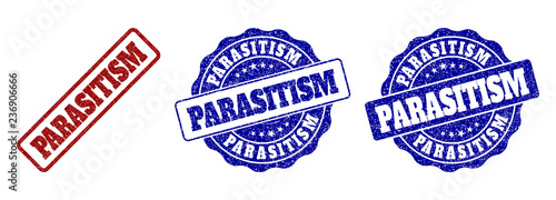 Photo  PARASITISM grunge stamp seals in red and blue colors
