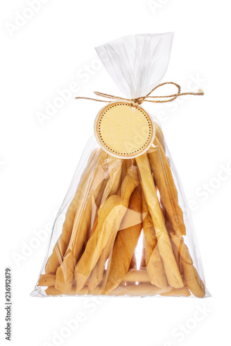 Cheese breadsticks freshly baked in a packer isolated on white background